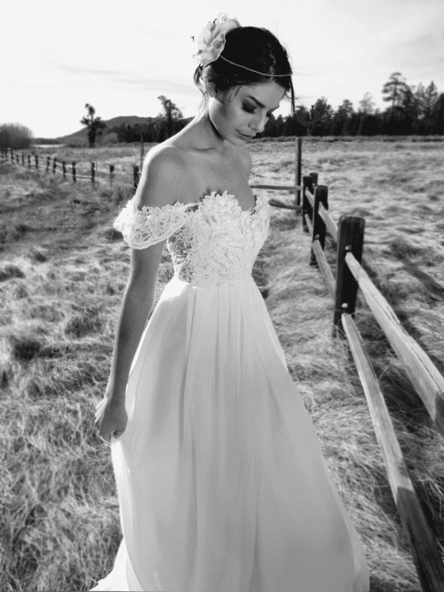 Vintage lace and chiffon off-the-shoulder wedding gown with backless illusion A-line silhouette.