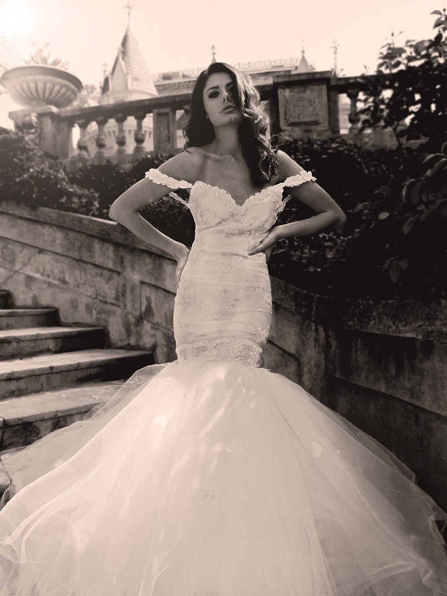 Off the shoulder mermaid wedding gown. French corded lace and rosettes. Lauren Elaine Bridal.