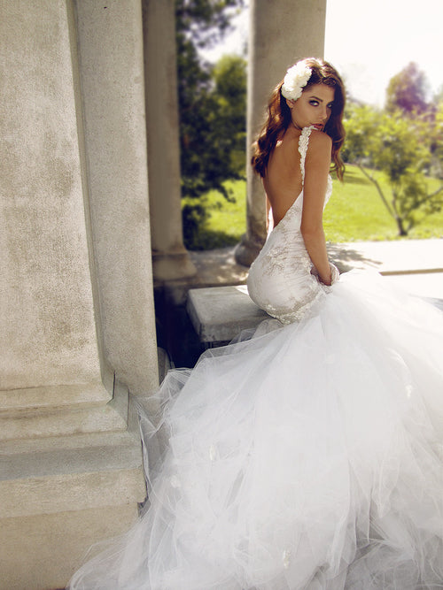 Backless mermaid gown with train. Illusion lace wedding dress.