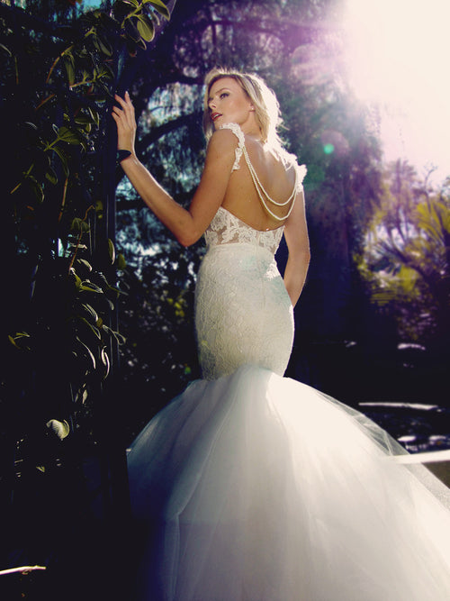 Backless mermaid wedding gown with lace and pearls and detachable tulle train