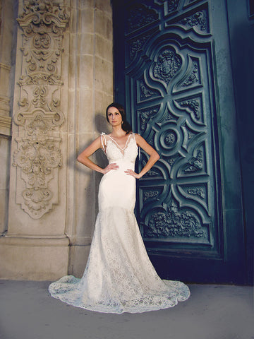 Ivy Gown by Lauren Elaine Bridal. Backless french lace illusion gown with train. Open Back wedding dress.