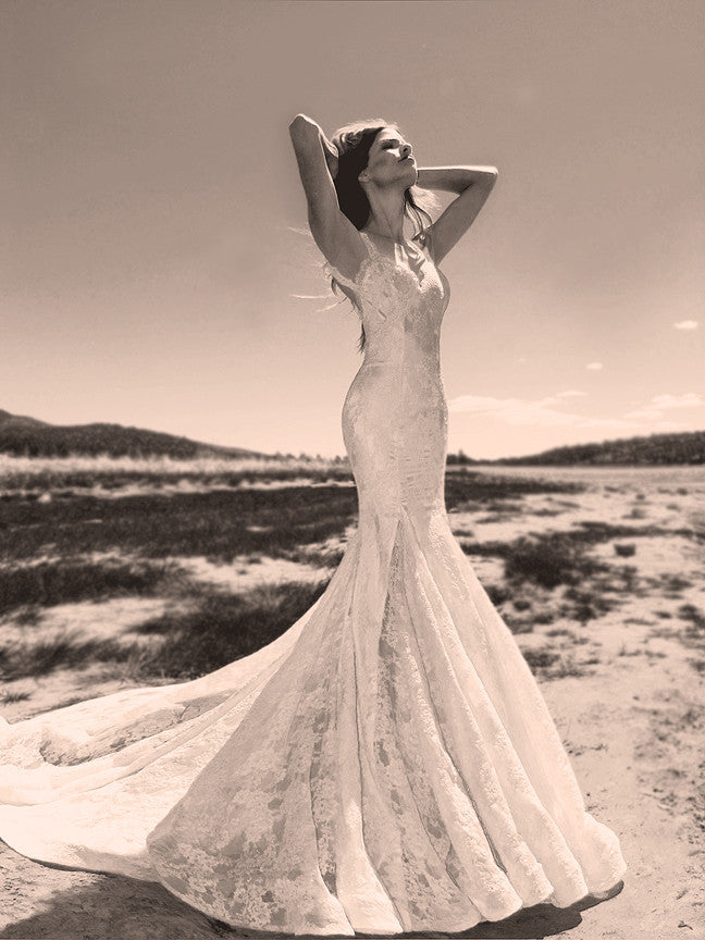 Backless lace mermaid wedding dress with scallop lace detailing by Lauren Elaine.