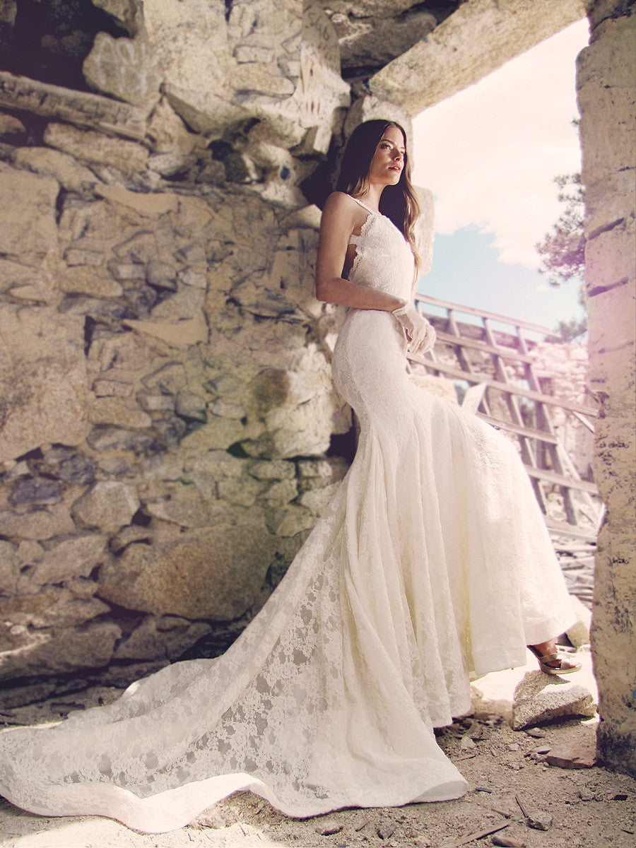 Backless lace mermaid wedding gown with full cathedral train and horsehair braid hemline by Lauren Elaine Bridal