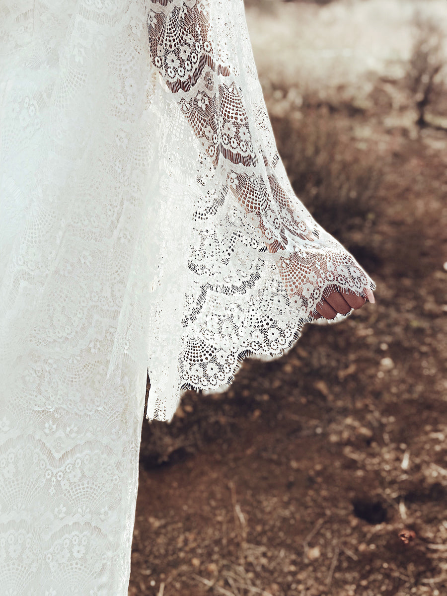 "Eyelash lace scallop detailing on the cape sleeves of the Lauren Elaine ""Larkin"" wedding dress."