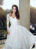Long sleeved lace wedding dress with sweetheart bodice and open back