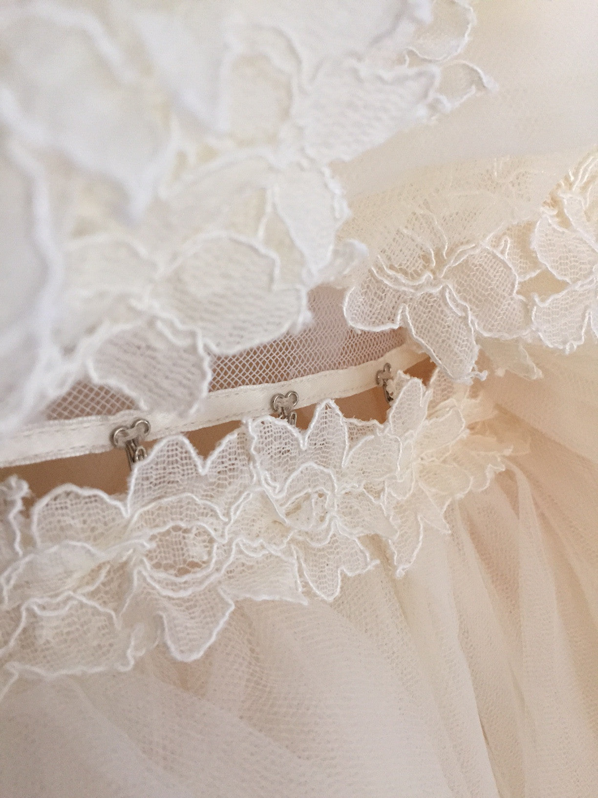 Detachable cathedral tulle mermaid train on the Lauren Elaine Aurelia wedding gown.