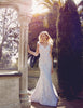 Mermaid trumpet lace illusion wedding gown with cap sleeves and pearls