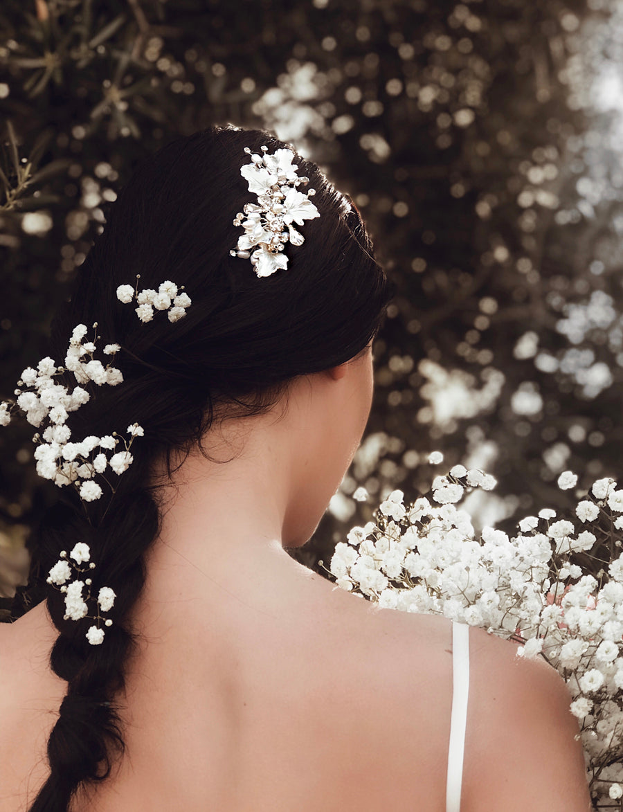 "A bride wears the Lauren Elaine ""Dewdrop"" wedding hair comb in Silver."