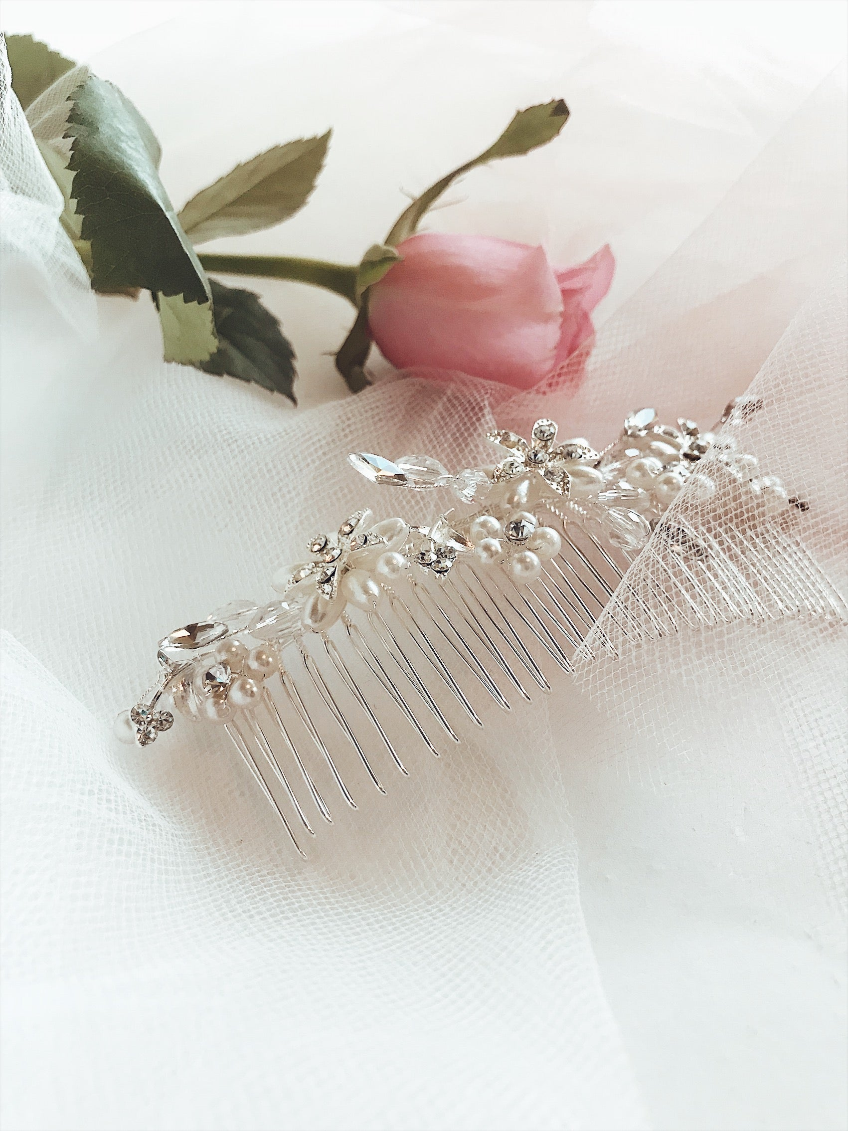 "Closeup detailing of the Lauren Elaine Bridal ""Honeysuckle"" wedding hair comb with crystal and pearl detailing"
