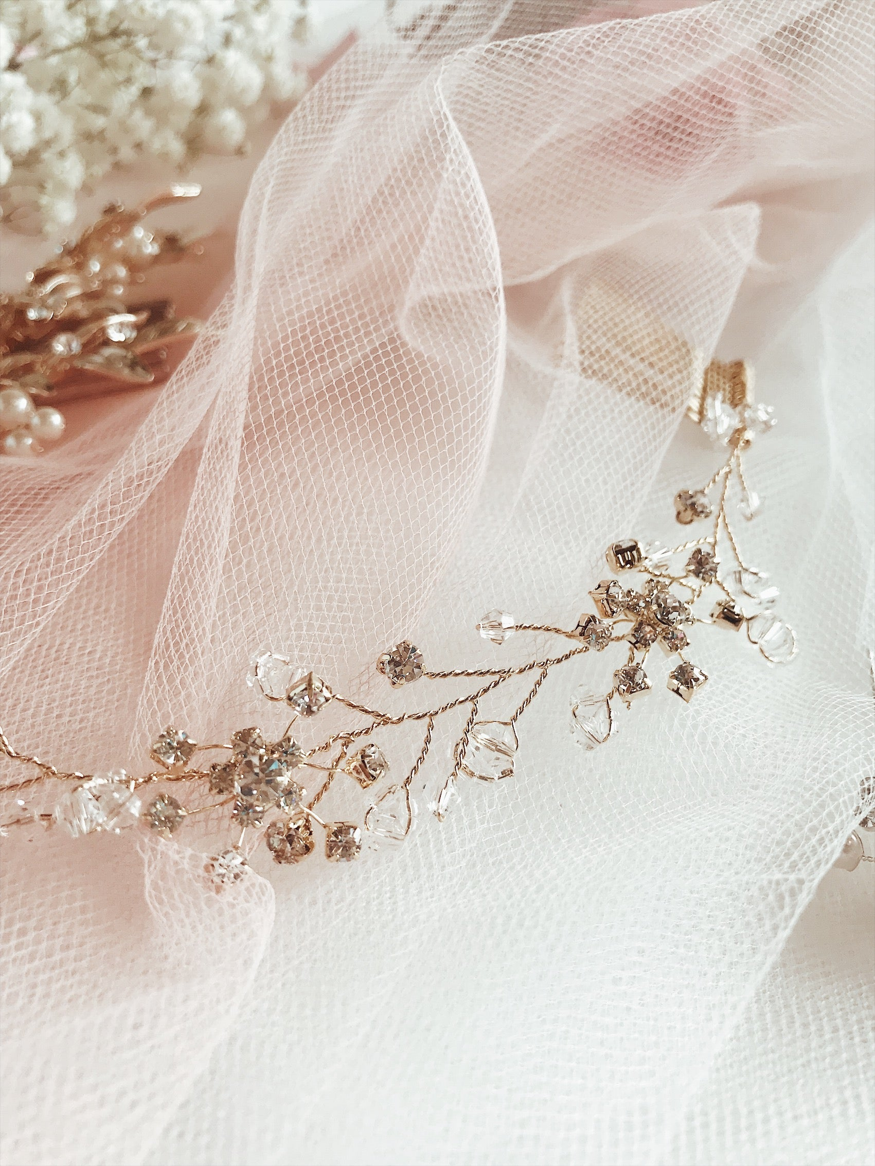 "Swarovski crystals and rose gold accents on the ""Laurel"" hair vine and tiara by Lauren Elaine Bridal Accessories"