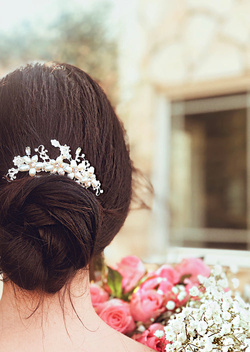 "A bride wears the ""Lilac"" pearl and crystal wedding hair comb by Lauren Elaine Bridal"