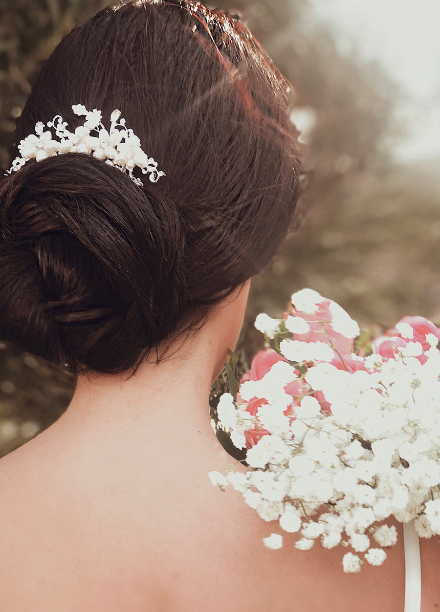 "A bride wears the ""Lilac"" cystal flower and pearl hair comb for wedding look"