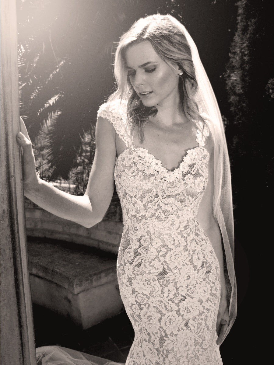 Capped sleeve sweetheart lace wedding gown with pearl and floral detailing