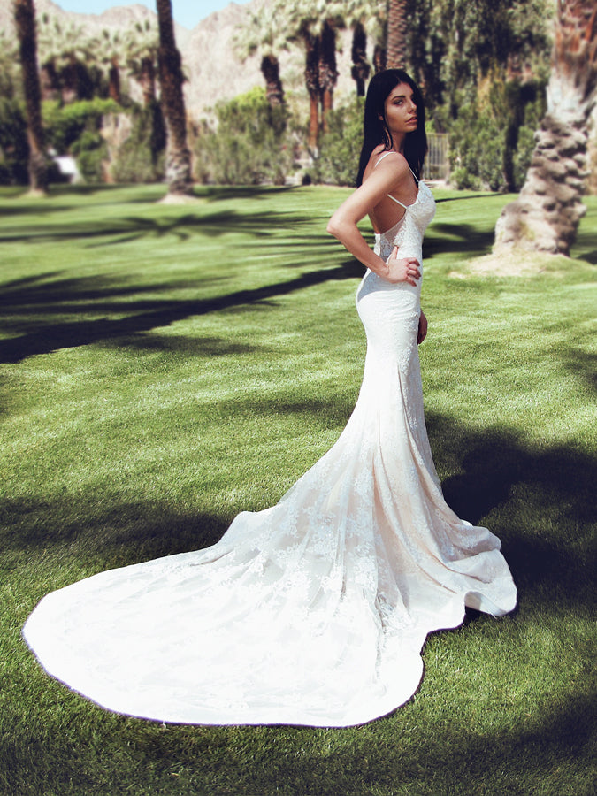 "Lauren Elaine ""Lumen"" trumpet wedding dress with cathedral train and sparkle backless silhouette"