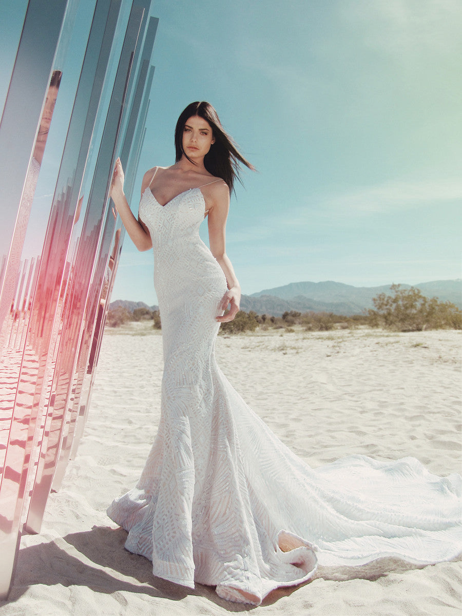 Prism sequin wedding dress with horsehair hemline and spaghetti straps by Lauren Elaine Bridal