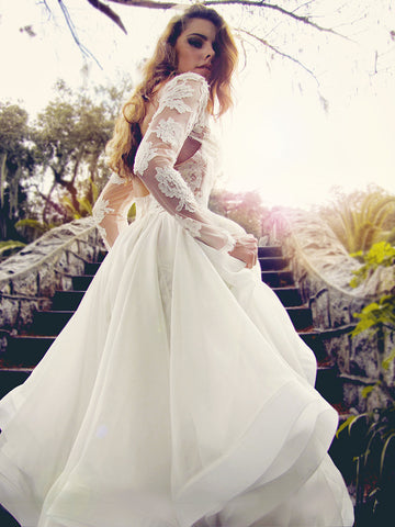Elise gown by Lauren Elaine. Long sleeved lace wedding gown.