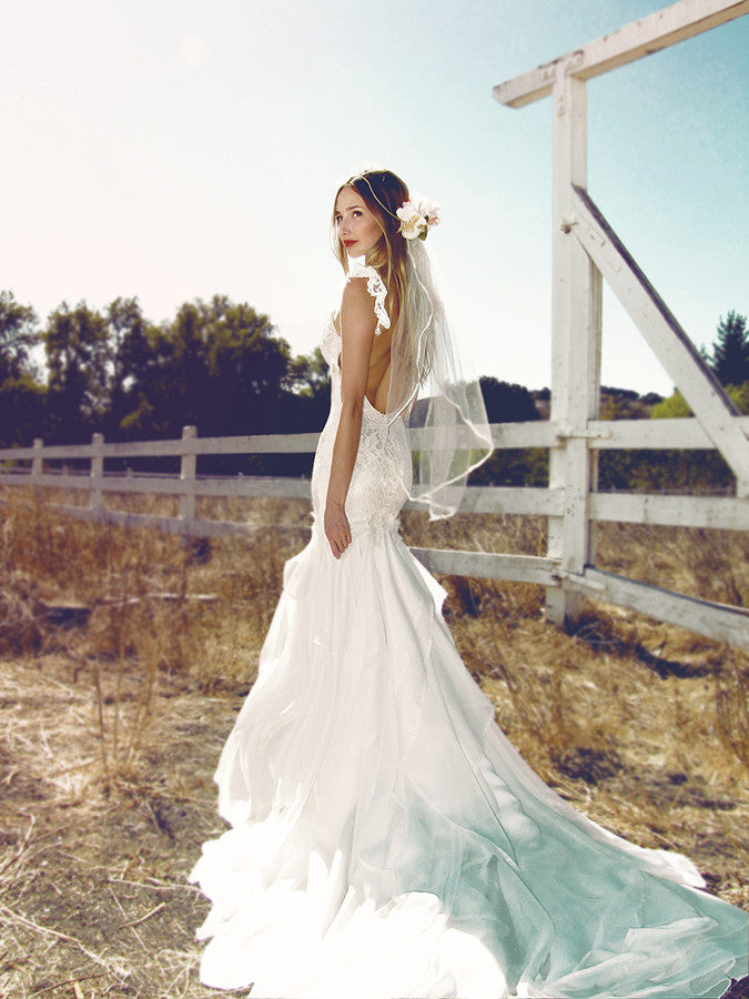 Bohemian wedding gowns by Lauren Elaine. Backless mermaid Aislin gown with chiffon train.