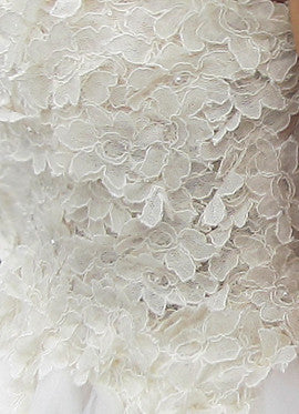 French corded lace detailing on the Monarch Gown by Lauren Elaine Bridal.