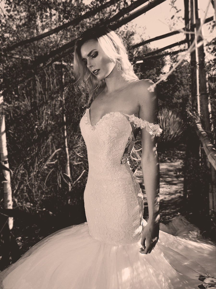 Off-the-shoulder sweetheart mermaid wedding gown with lace and tulle.