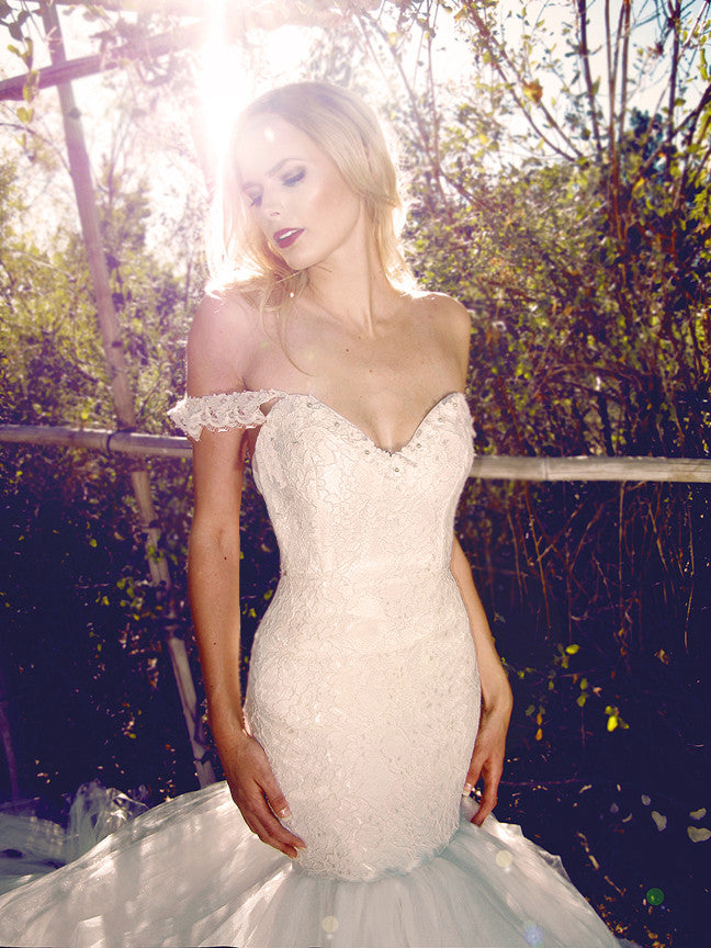 Sexy off-the-shoulder mermaid wedding gown by Lauren Elaine.