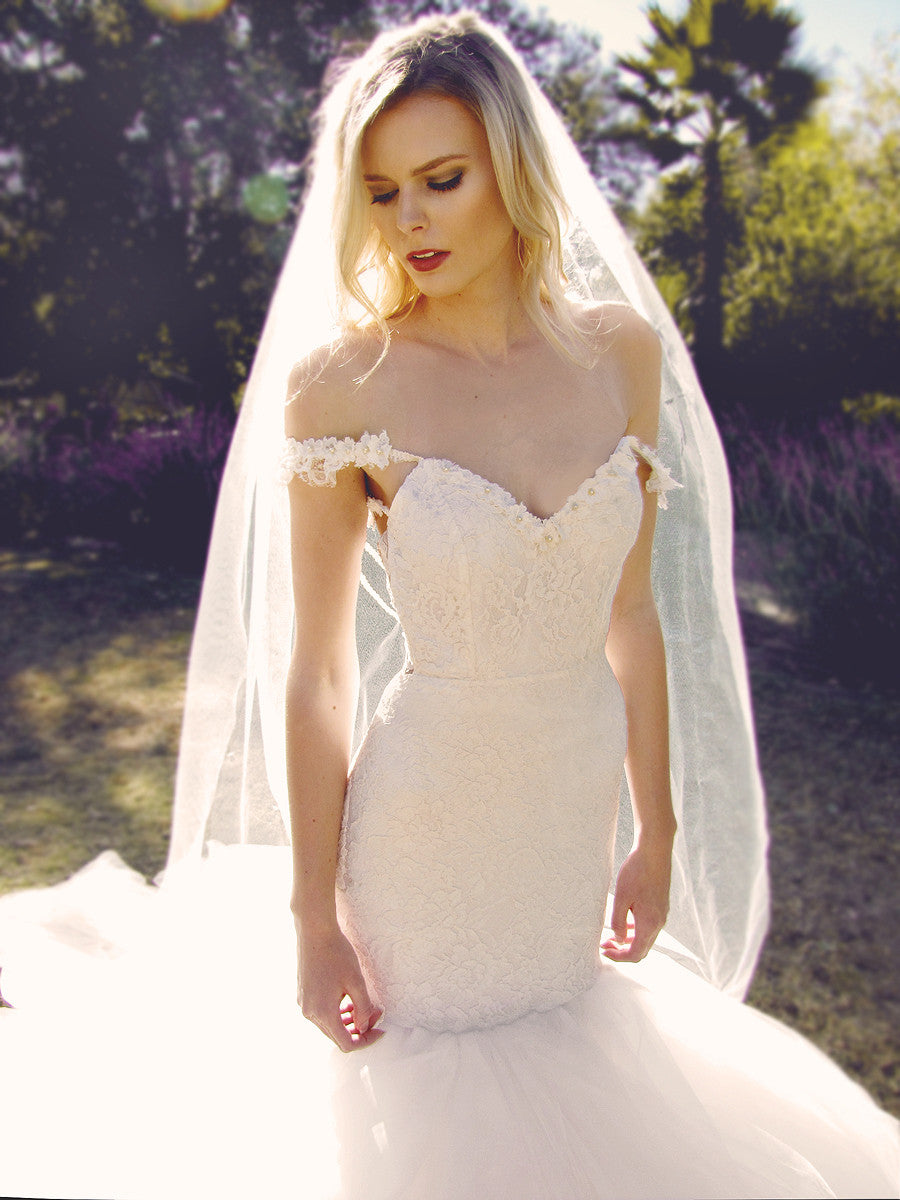 Off-the-Shoulder wedding gowns by Lauren Elaine Bridal. Lace mermaid wedding gown.