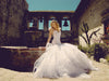Horsehair mermaid wedding gown with cathedral train. By Lauren Elaine Bridal.