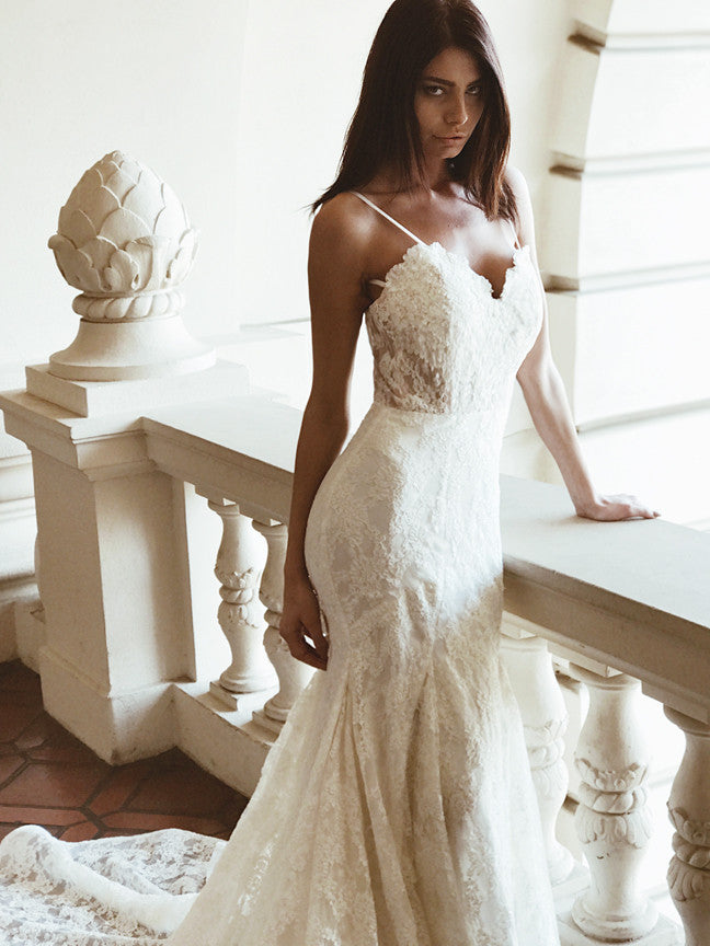 Sweetheart lace illusion mermaid wedding dress with cathedral train and kick pleat detailing by Lauren Elaine Bridal.