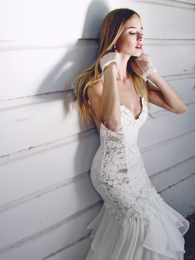 Sexy backless mermaid / trumpet wedding gown by Lauren Elaine.  Plunging sweetheart bodice with floral lace detailing.