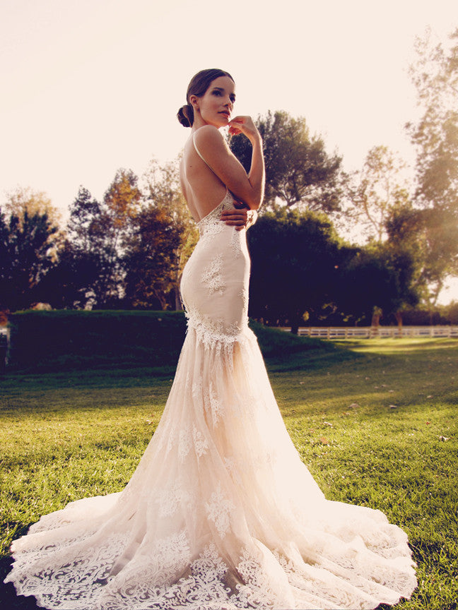 Vaile by Lauren Elaine features an illusion open back with V-cut thigh line and blushing nude color with ivory scalloped lace overlay.
