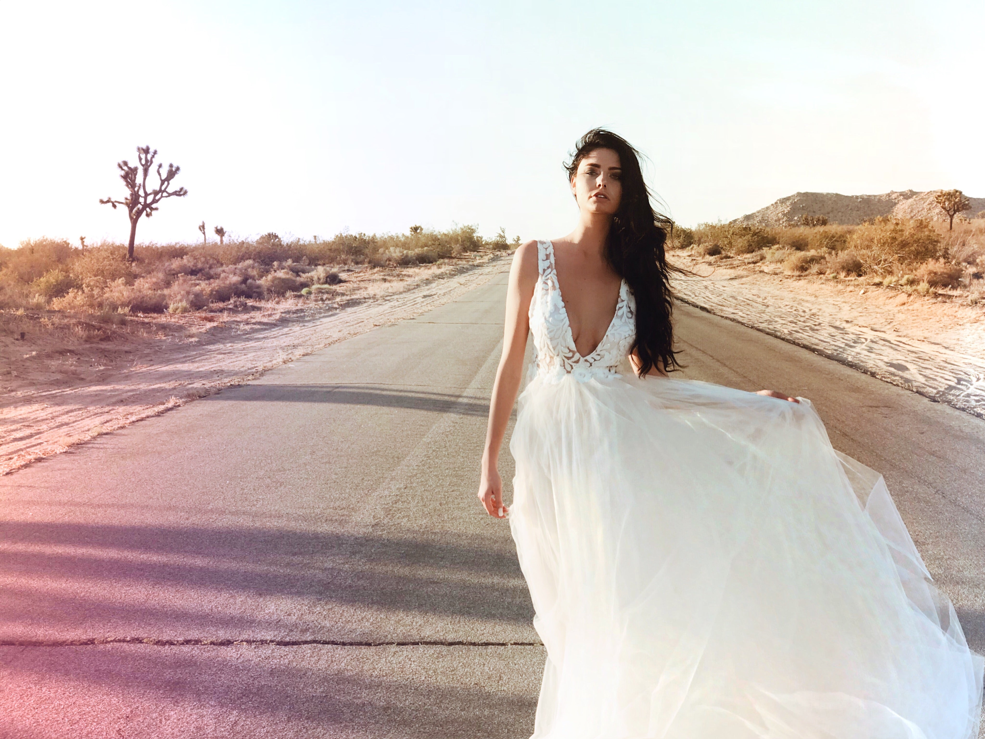 Tulle and sequin v-neck illusion designer wedding gown by Lauren Elaine Bridal