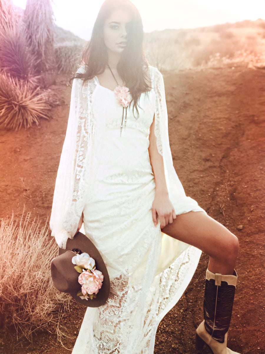 Romantic western cowgirl inspired lace wedding dress with sheath silhouette and chapel train.