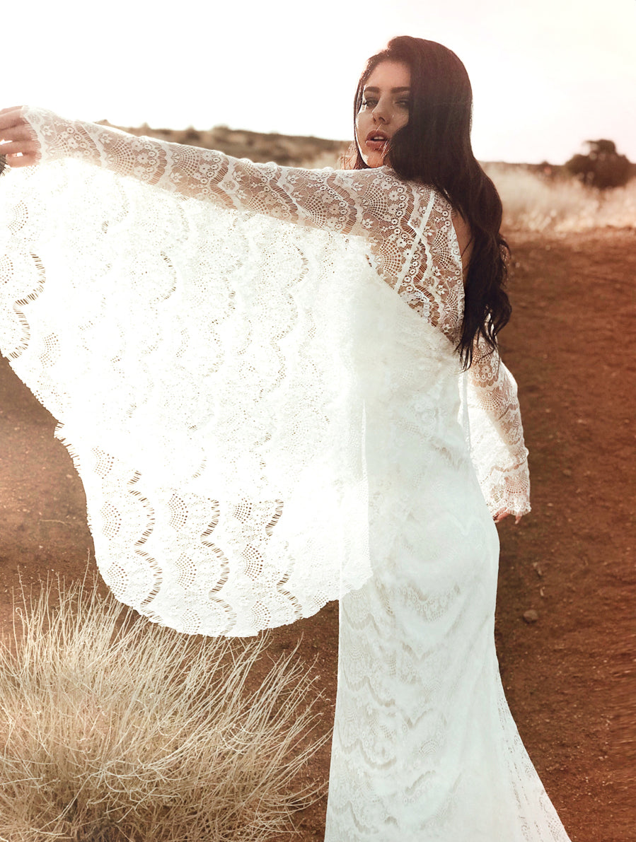 "Lace angel wing cape sleeves on the Lauren Elaine ""Larkin"" wedding dress from the Pearl by Lauren Elaine Bridal collection"