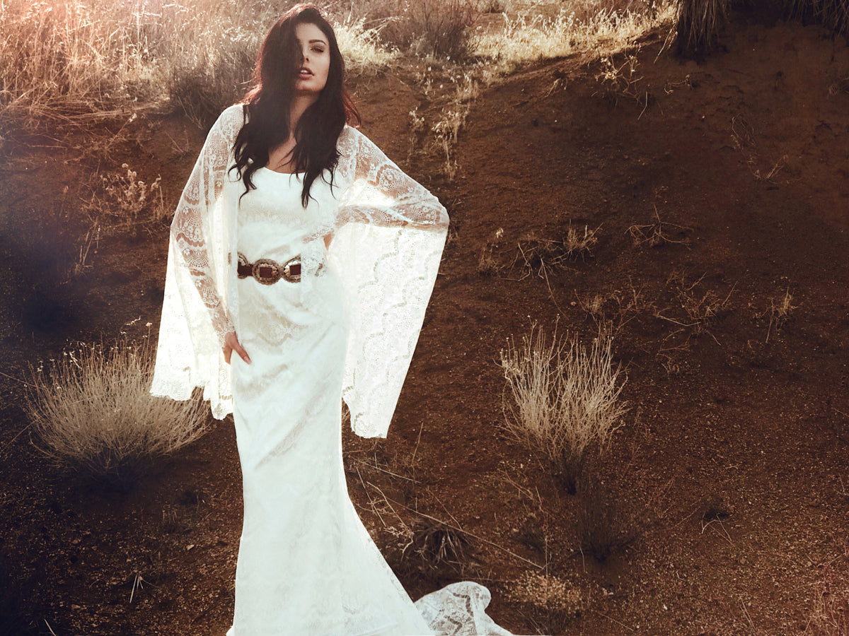 Bohemian western and festival inspired wedding dress with eyelash lace and cape sleeves. Larkin by Lauren Elaine Bridal.