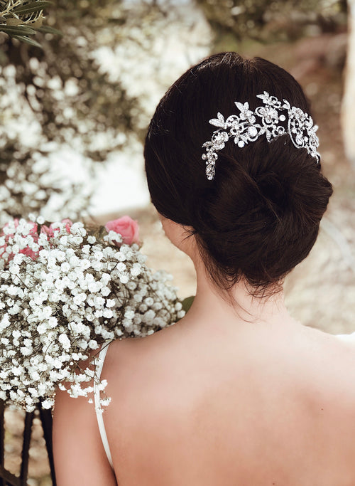 "A bride wears the ""Zinnia"" crystal wedding hair comb from Lauren Elaine Bridal Accessories Collection"