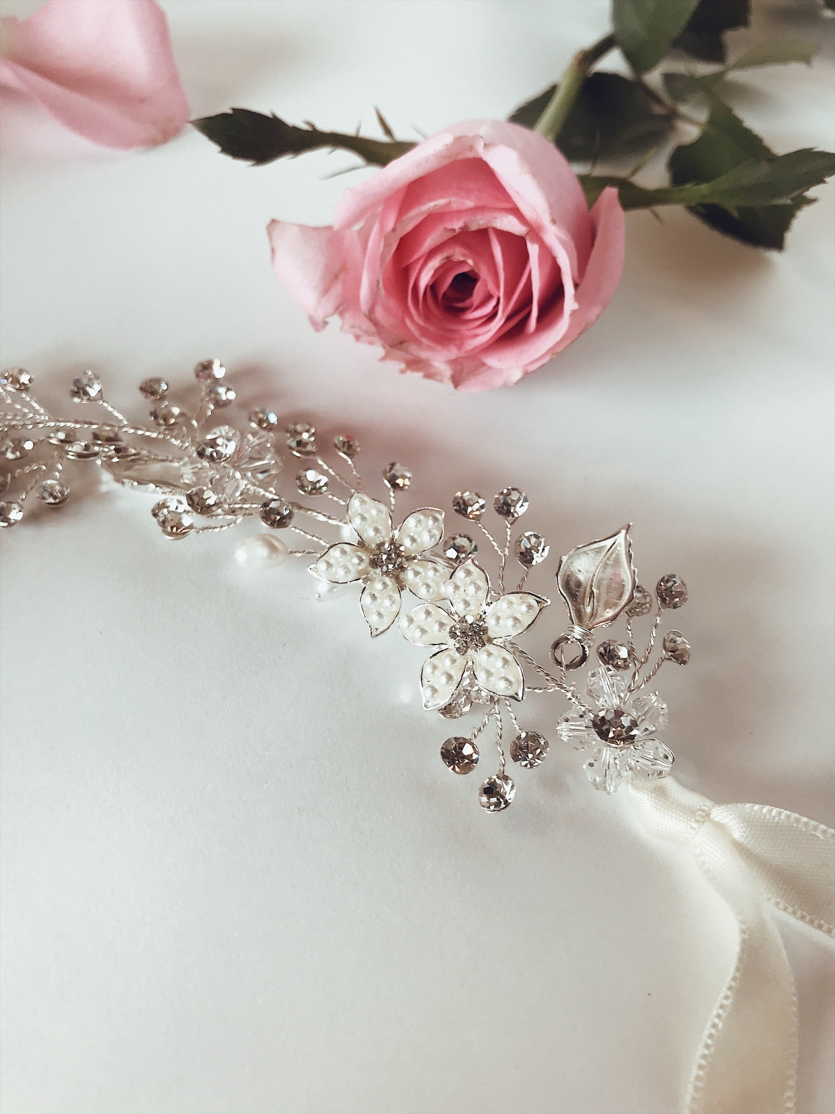 "A closeup view of the Lauren Elaine ""Verbena"" hair vine and flower crown by Lauren Elaine Bridal"