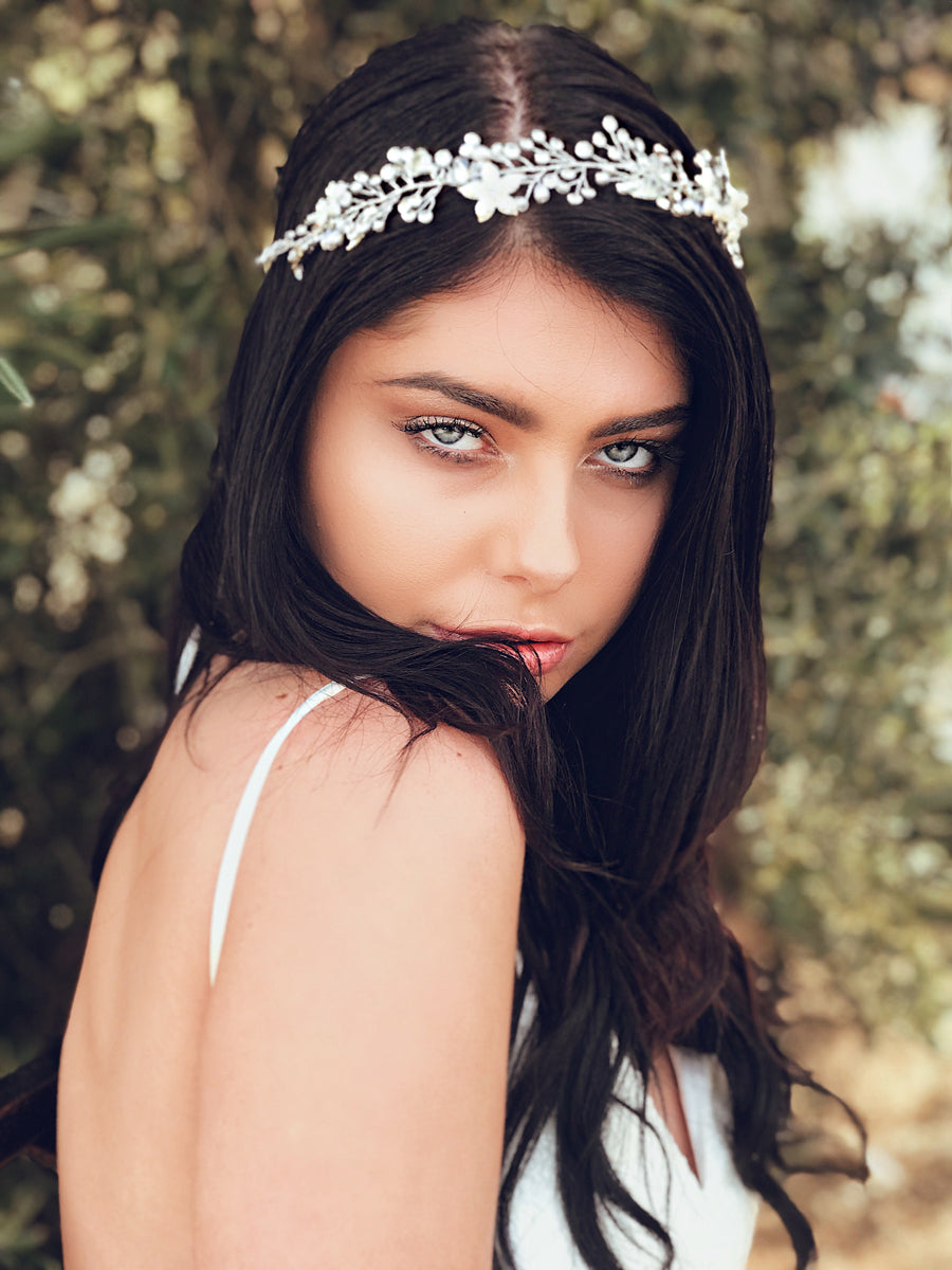 "A model wears the ""Verbena"" silver crystal and pearl flower crown from Lauren Elaine Bridal"