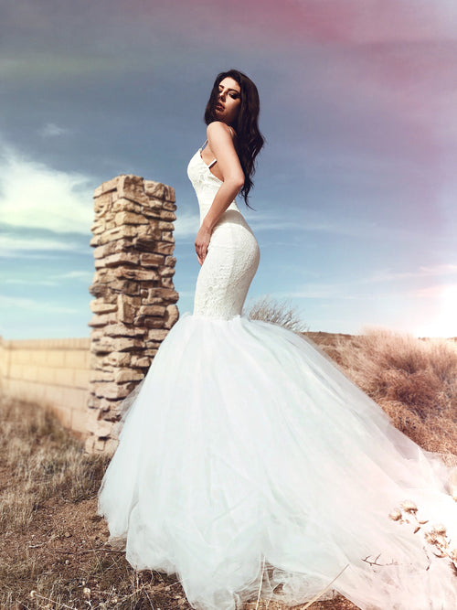 Backless sparkle lace mermaid wedding dress with 6ft cathedral train and satin spaghetti straps. Lola from the Pearl by Lauren Elaine Bridal Collection.