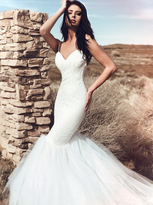 Sexy sweetheart mermaid wedding dress with sparkle sequin detailing and poufy tulle skirt with cathedral train. Lola from the Pearl by Lauren Elaine Bridal Collection.
