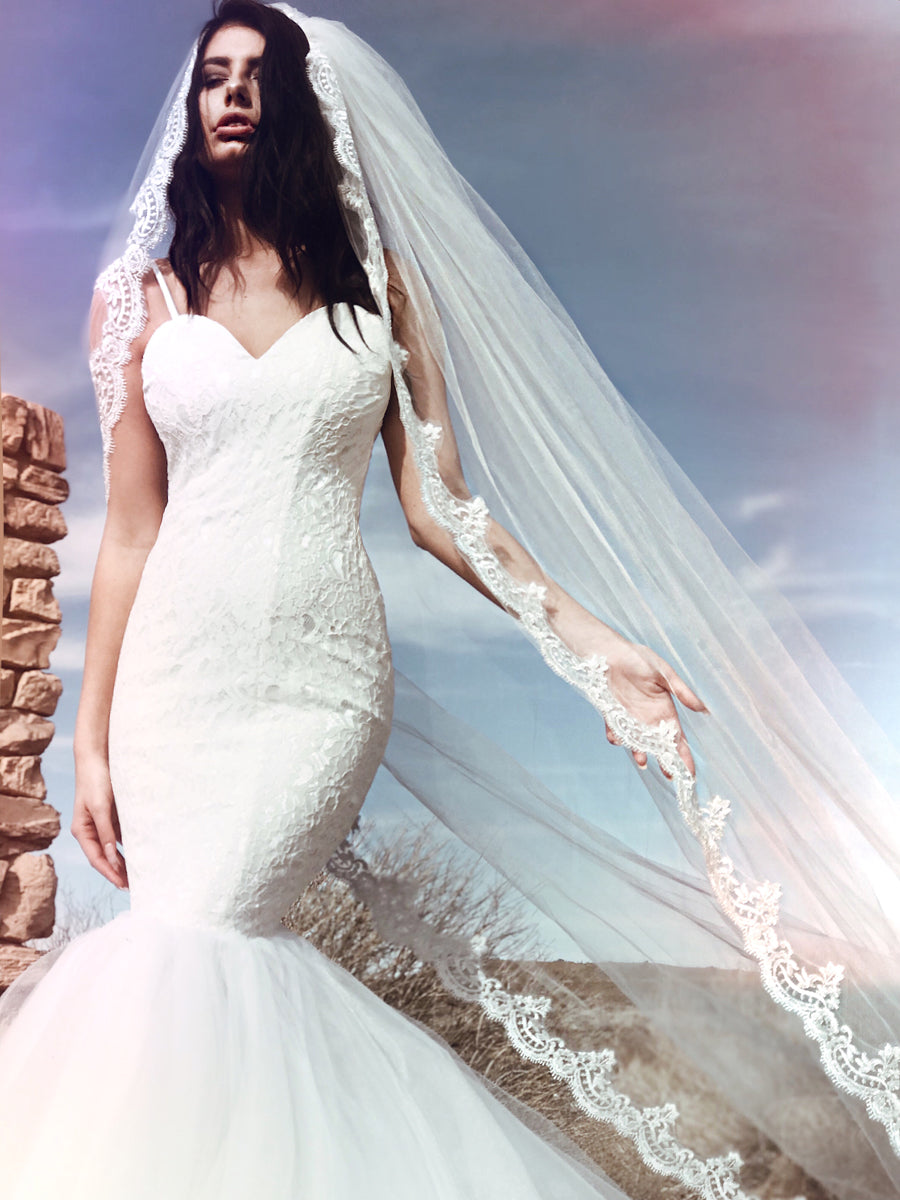 Sleek and modern mermaid wedding dress with sparkling sequin lace and sweetheart bodice by Lauren Elaine Bridal.