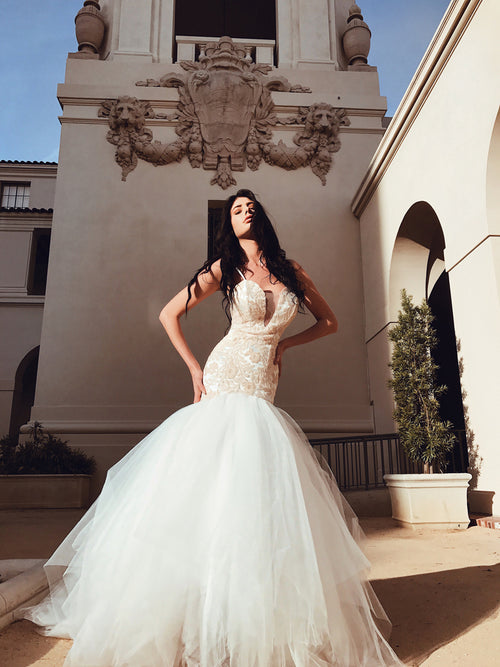Sequin blush mermaid wedding dress with deep v illusion neckline and 8ft cathedral train