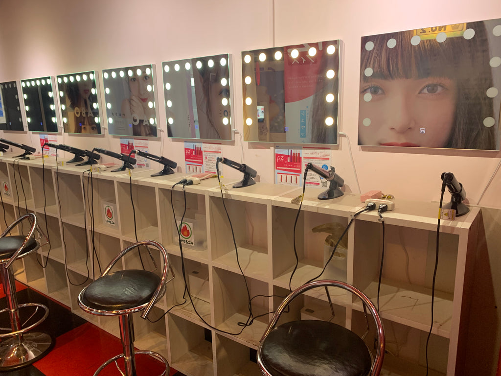 Japanese purikura photo booth dressing table and make up area in game arcade in Japan