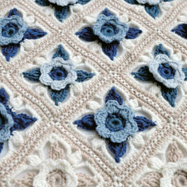 Willow Blossom Crochet Cot Blanket Pattern by Janie Crow