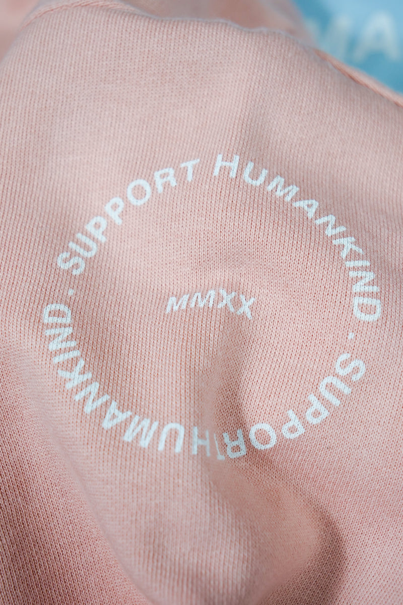 SUPPORT HUMANKIND PASTEL ROSE CROPPED SWEATSHIRT