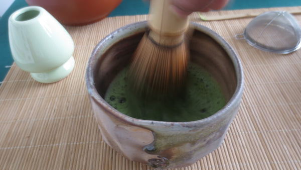 Photo of whisking Matcha.