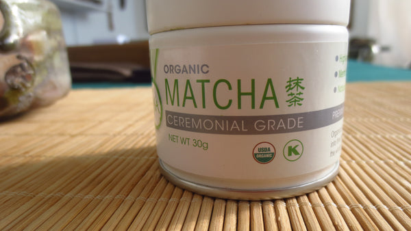 Photo of container of ceremonial matcha powder