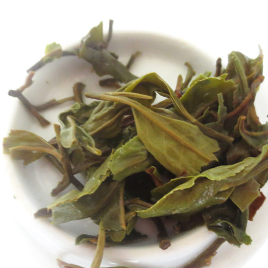 Infused leaves of first flush Darjeeling. Looks very similar to a green tea infusion.