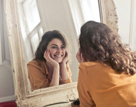 woman smiling in mirror