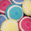assortment of turquoise, yellow, pink and blue hand crocheted 'Joy' cushions, 100% cotton