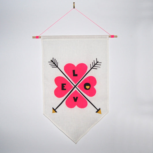 Neon pink 'LOVE' with arrows, hand screen printed 100% cotton flag hung on dowel rod