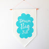 Turquoise 'Dream Big Kid' hand screen printed 100% cotton kids flag hung on dowel rod
